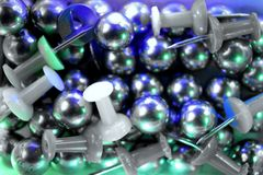 Push pins and metal balls stock photo