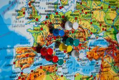Push pins on a physical geographic map royalty free stock photography