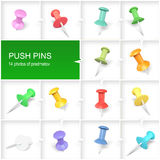 PUSH PINS. Set of push pins in different colors thumbtacks top view isolated on white Royalty Free Stock Image