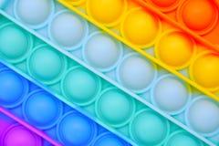 Free Push Pop It Bubble Fidget Sensory Toy Background Royalty Free Stock Image - 220055626