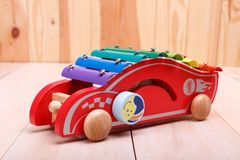 Push Pull Toys. Are made in the form of red car with a stick are interesting for toddlers stock images