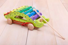 Push Pull Toys. Made in the form of red car with a stick are always interesting for toddlers stock photo
