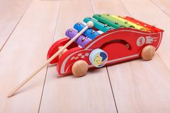 Push Pull Toys. Made in the form of red car with a stick are interesting for toddlers stock photo