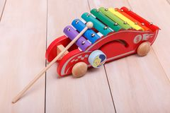 Push Pull Toys. Made in the form of red car with a stick are ready to play with stock photo