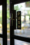 Push sign on a door Stock Images
