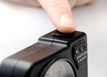 Push snooze button. A finger pushing snooze button on an alarm clock Royalty Free Stock Image