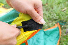 Push the tent pole to socket of tent Stock Photography