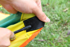 Push the tent pole to socket of tent Royalty Free Stock Photography