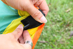 Push the tent pole to socket of tent Royalty Free Stock Image