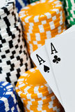 Push them all in. A pair of black aces in front of a pile of poker chips Stock Images