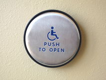 Push to open button. Photo of a disabled door push to open button royalty free stock images