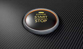 Push To Start Carbon Fibre Button. A closeup of a modern car start and stop button with blue lights on a carbon fibre textured surface Stock Photo