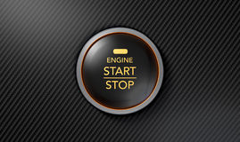 Push To Start Carbon Fibre Button. A closeup of a modern car start and stop button with blue lights on a carbon fibre textured surface Royalty Free Stock Image