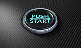 Push To Start Carbon Fibre Button. A closeup of a modern car start and stop button with blue lights on a carbon fibre textured surface Stock Image
