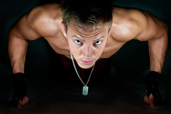 Push-up. Muscular male kickboxer doing push-up on his knuckles Royalty Free Stock Photo