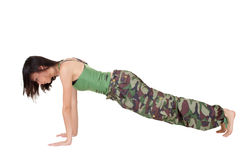 Push-up. Young woman doing excise(push-up) isolated over white Royalty Free Stock Images