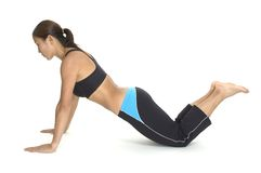 Push Up 4. A female fitness instructor demonstrates the finishing position of a kneeling push up Stock Photo