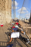 Push-up at Brooklyn Bridge in New York Stock Photo