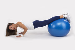 Push Up on an Exercise Ball Royalty Free Stock Image