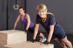 Push up exercise on a box  sport woman Stock Images