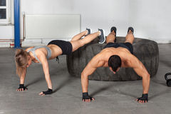 Push up exercise on a tire crossfit training Stock Photos