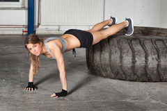 Push up exercise on a tire crossfit training. In a gym Royalty Free Stock Image