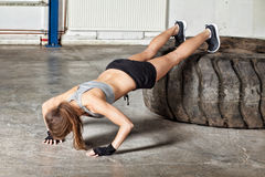 Push up exercise on a tire fitness training Stock Photo