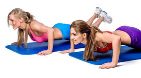 Push-up exercise. Young women doing push-up exercise stock images