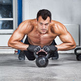 Push up on kettlebells crossfit fitness training Stock Image