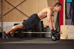 Push up on kettlebells in a gym Stock Images