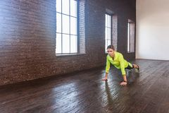 Push up or press ups. Plank. Motivation, fitness concept. Studio shot Royalty Free Stock Photos
