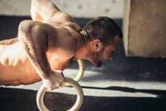 Push up with rings. Push up with gymnastic rings in fitness gym stock photos