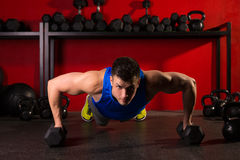Push-up strength man hex dumbbells workout at gym. Push-up strength man hex dumbbells pushup exercise workout at gym stock photography