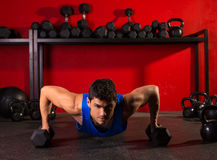 Push-up strength man hex dumbbells workout at gym. Push-up strength man hex dumbbells pushup exercise workout at gym Royalty Free Stock Image