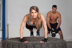 Push up on a tire crossfit training Royalty Free Stock Image