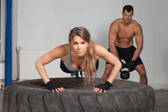 Push up on a tire crossfit training Stock Image