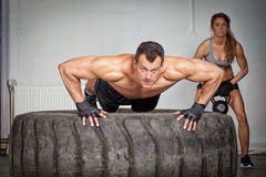Push up on a tire crossfit training Royalty Free Stock Photo