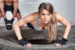 Push up on a tire crossfit training. In a gym Stock Image
