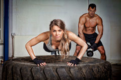 Push up on a tire crossfit training. In a gym Stock Images