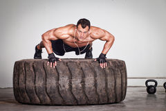 Push up on a tire crossfit training Royalty Free Stock Photography