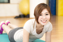 Push Up. A young Asian woman doing push ups on a mat Stock Images