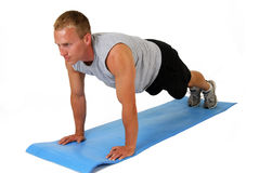 Push Ups. A handsome man doing push ups Royalty Free Stock Image
