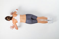 Push-ups. Aerial view of a fit woman doing push-ups Royalty Free Stock Photo