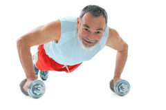 Push-ups. Senior man  doing push-ups exercise in gym Royalty Free Stock Images