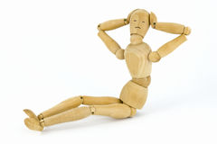 Push-ups. Sitting wooden toy man on a white background as a concept of press-ups, with copy-space Stock Image