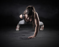 Push-Ups. Young Woman Doing Push-Ups Stock Photos