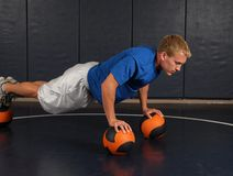 Push Ups. A young man doing push ups in the gym Royalty Free Stock Photo