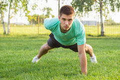 Push-ups. Athletic male doing push-ups, outdoors Stock Images