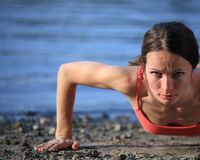 Push-ups on beach Stock Images