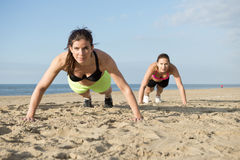 Push ups on a beach Royalty Free Stock Photography